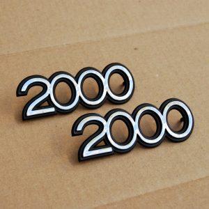 """Datsun Roadster """"2000"""" Side Fender Emblems Set *NOS*"""