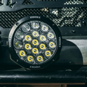 CG2 Multi LED Cannon Lights, mounted to front truck bumper. Broad driving combination beam pattern. Waterproof, durable.